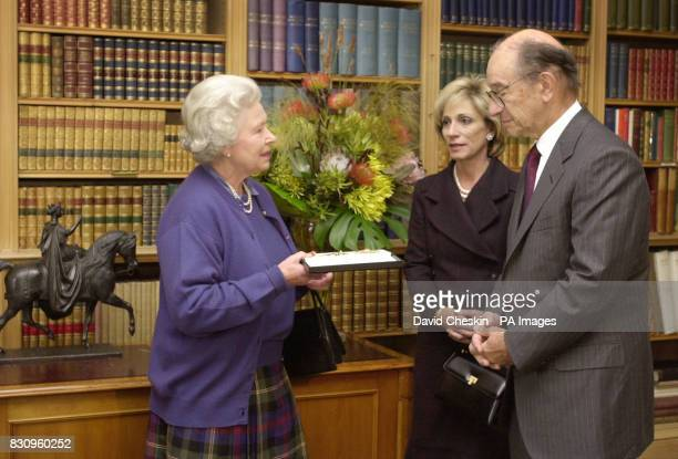 US Fedreral Reserve Chairman Alan Greenspan collects his honorary knighthood from the Queen with his wife Andrea Mitchell at Balmoral castle in the...
