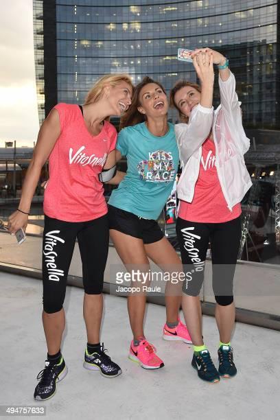 Fedrica Fontana Martina Colombari and Elena Barlo attend We Own The Night Milan Women's 10km Run on May 30 2014 in Milan Italy