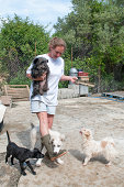 Volunteer at a dog sanctuary feeding the dogs