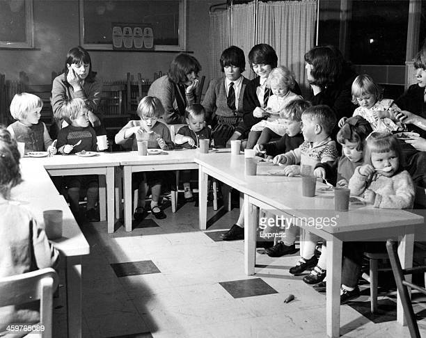 Feeding time for babies and toddlers and a lesson in mothering for the big girls in this Smithhills secondary school in Bolton Lancashire England...