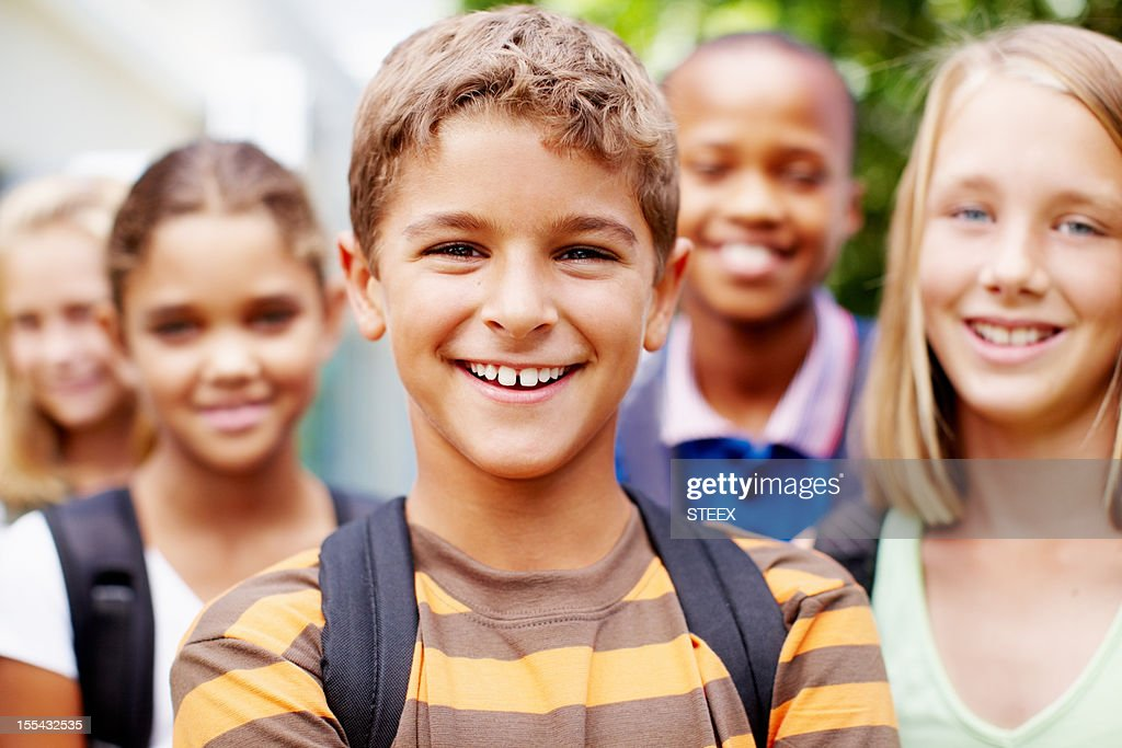 Feeling good about myself, hanging out with schoolmates : Stock Photo