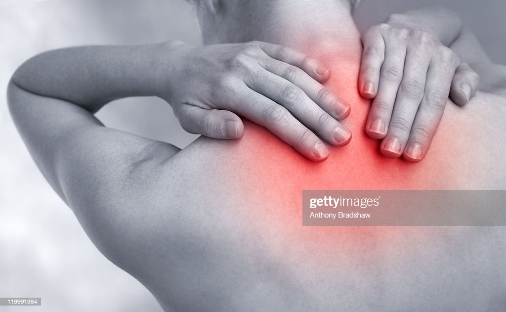 Feeling pain at base of neck : Stock Photo