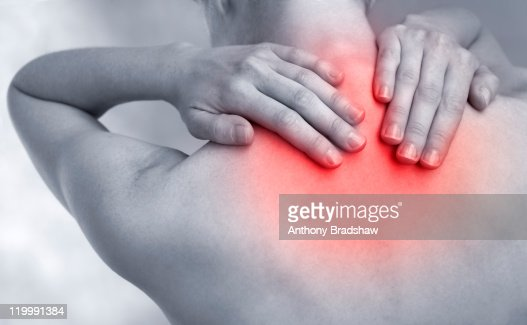 Feeling pain at base of neck : Foto de stock