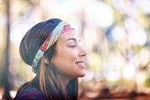 Shot of a beautiful young woman enjoying a day outdoors