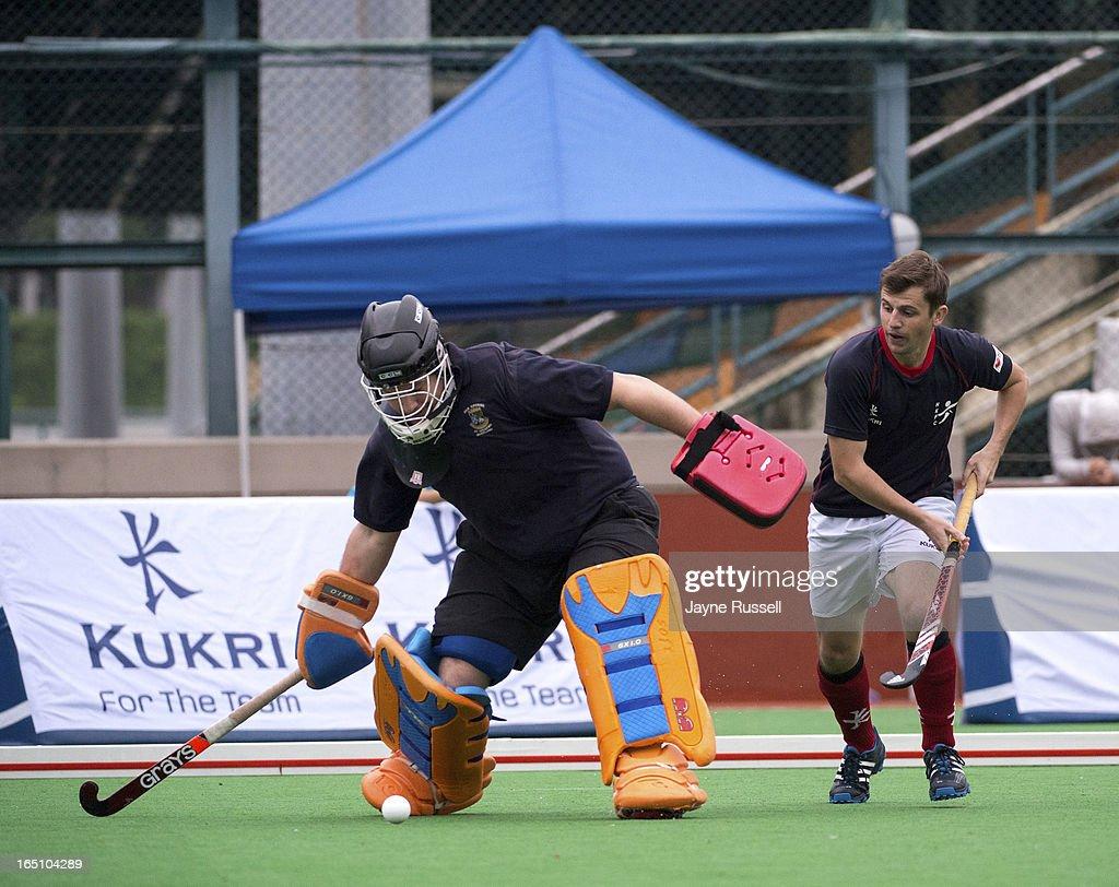 Feerk ten Hoor goalkeeper for the Air Team (Holland) (L) deflects a goal attempt by Owen Hughes #10 Water Team (Great Britain)( R)during Day Three of the 2013 Hong Kong 6's at Hong Kong Football Club on March 30, 2013 in Hong Kong, Hong Kong.