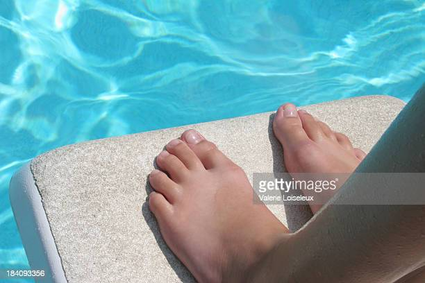 Feet and diving board