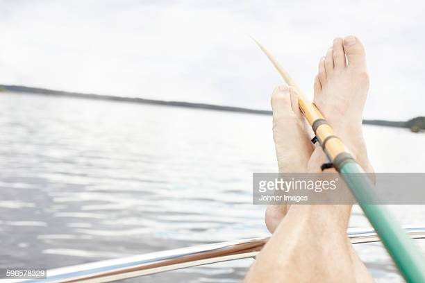 Feet and fishing rod
