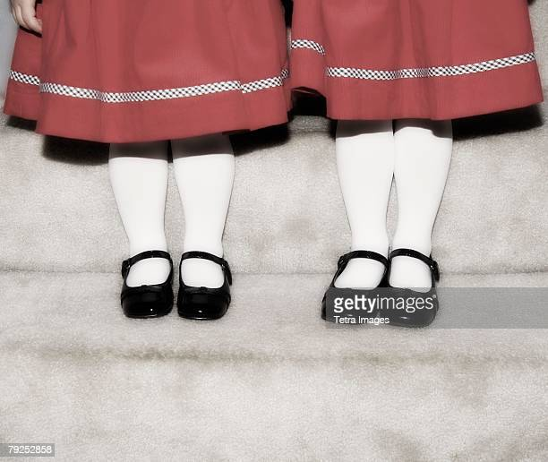 Feet and legs of two girls