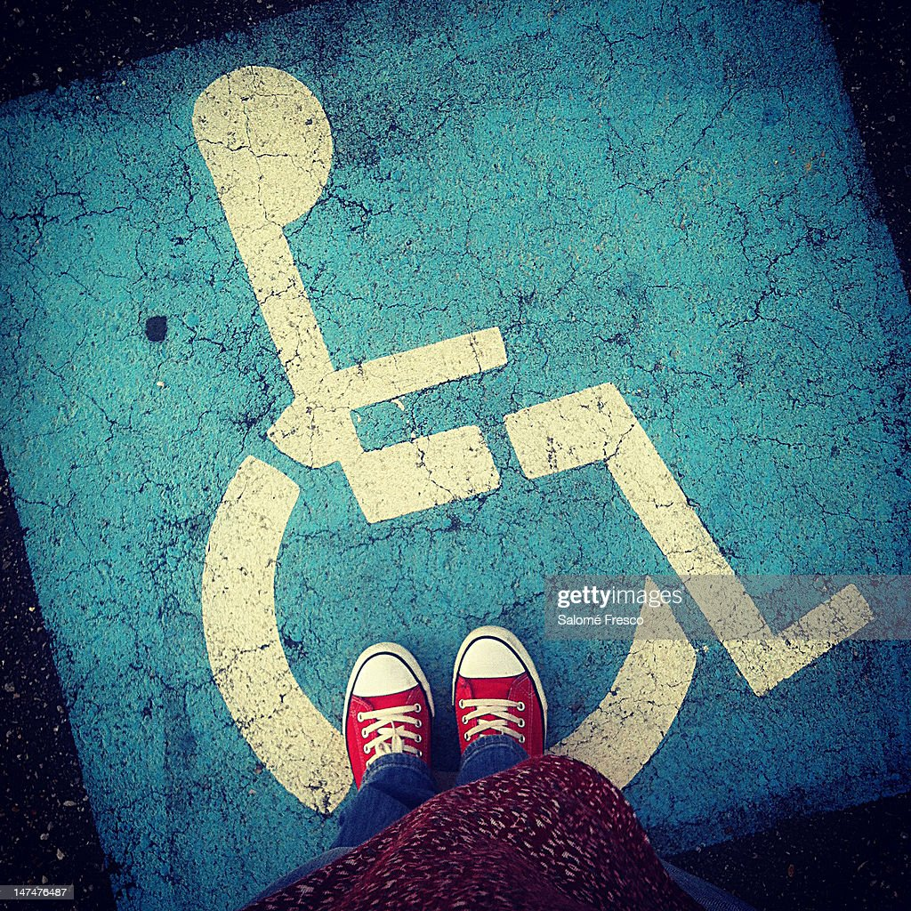 Feet and sign of wheelchair