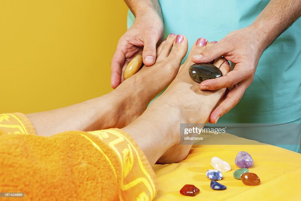 Feet antistress massage : Stock Photo