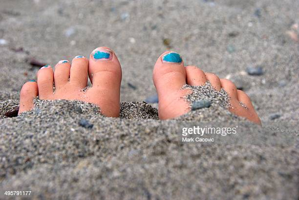 Feet buried in sand