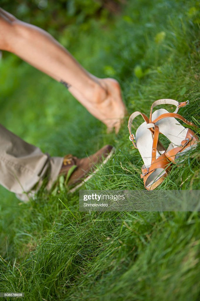 feet guys and girls on the grass : Stock Photo