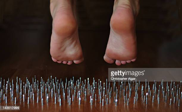 Feet hanging over nails