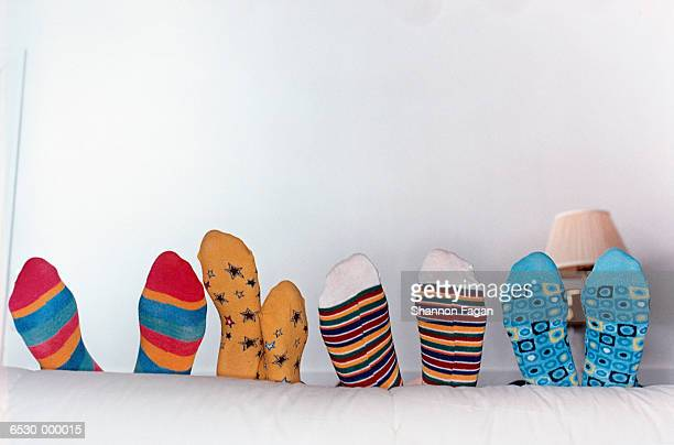 Feet in Assortment of Socks