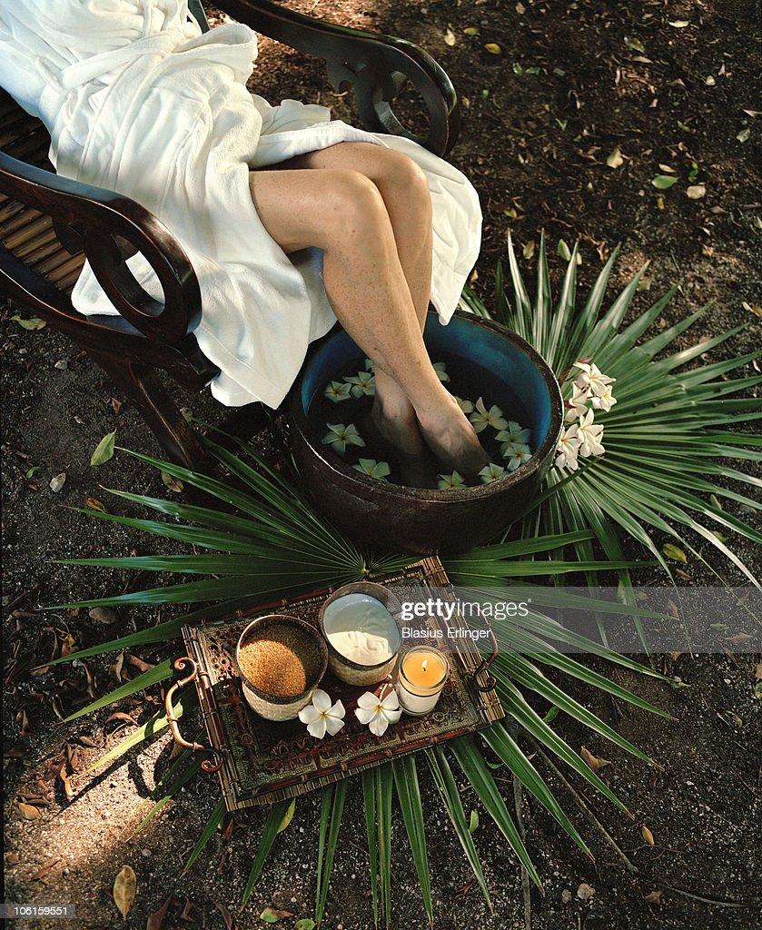 Feet In Flower Water : Stock Photo
