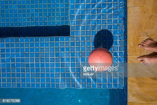 feet in the pool : Stock Photo