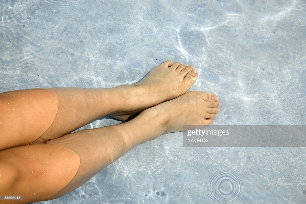 Feet in water : Stock Photo