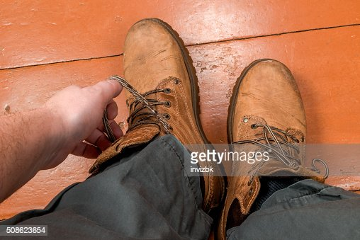 Feet in winter boots : Stock Photo