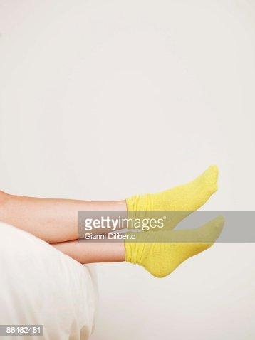 Feet in yellow socks