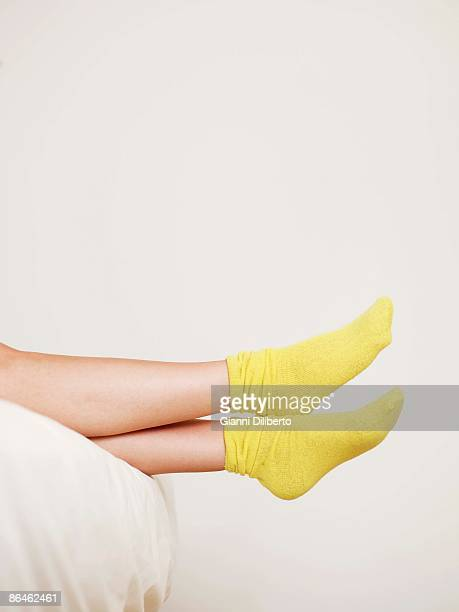 Feet in yellow socks