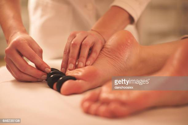 Feet massage with lava stones