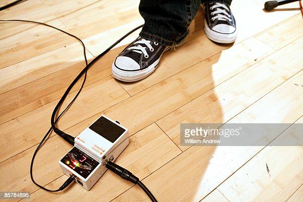 Feet near guitar pedal