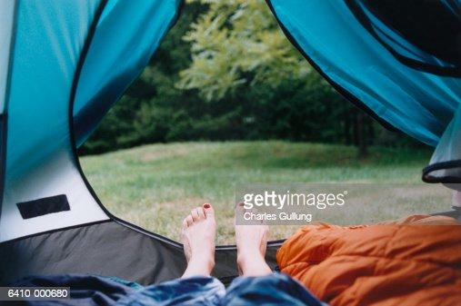 Feet Near Tent Opening : Stockfoto