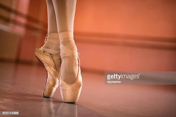 Feet of ballerina on tiptoe.