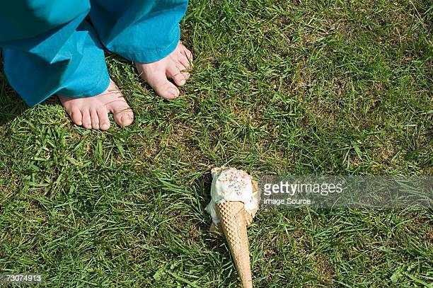 Feet of child and dropped ice cream