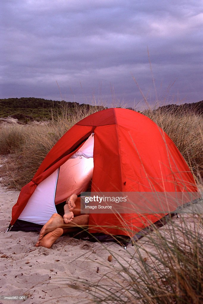 Feet of couple in tent : Stock Photo