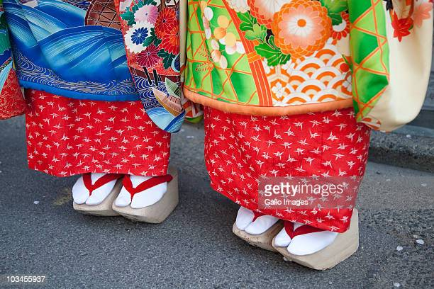 Feet of Geisha in traditional wooden sandals in Gion district, Kyoto, Honshu island, Japan