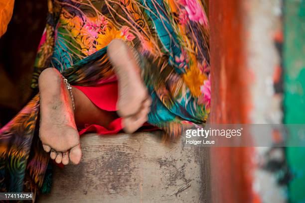 Feet of praying woman inside Shiva Temple