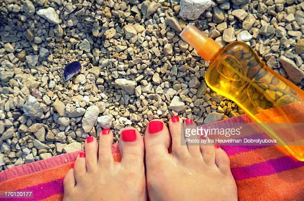 Feet of woman on the beach