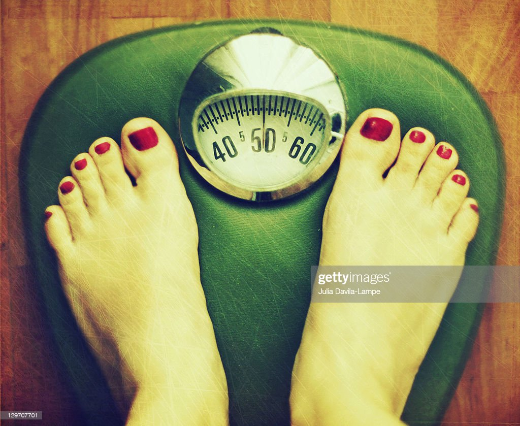 Feet on balance/scale : Stock Photo