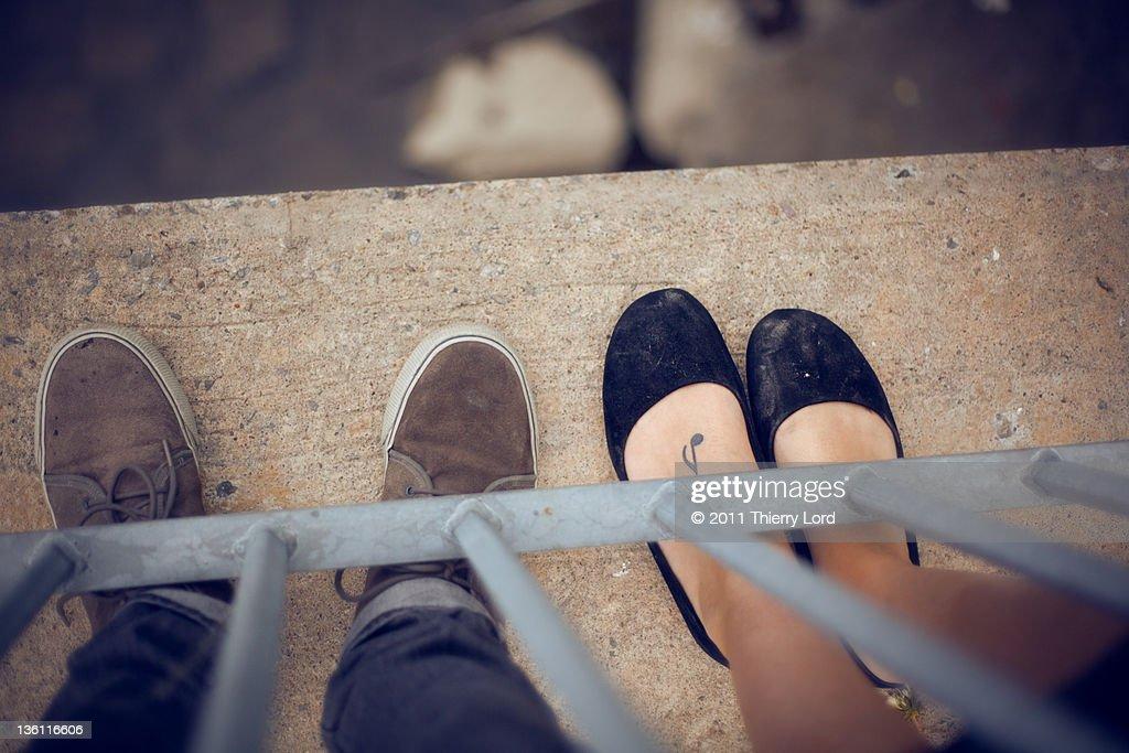 Feet on concrete : Stock Photo