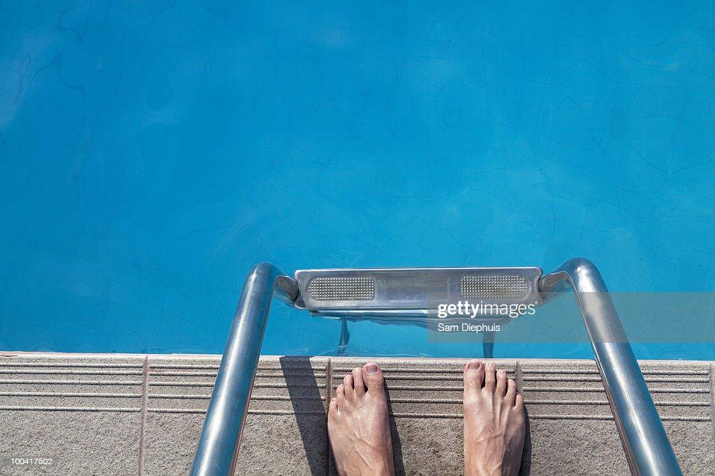 Feet On Edge of Pool : Stock Photo