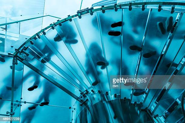 Feet On Glass Spiral Stairs