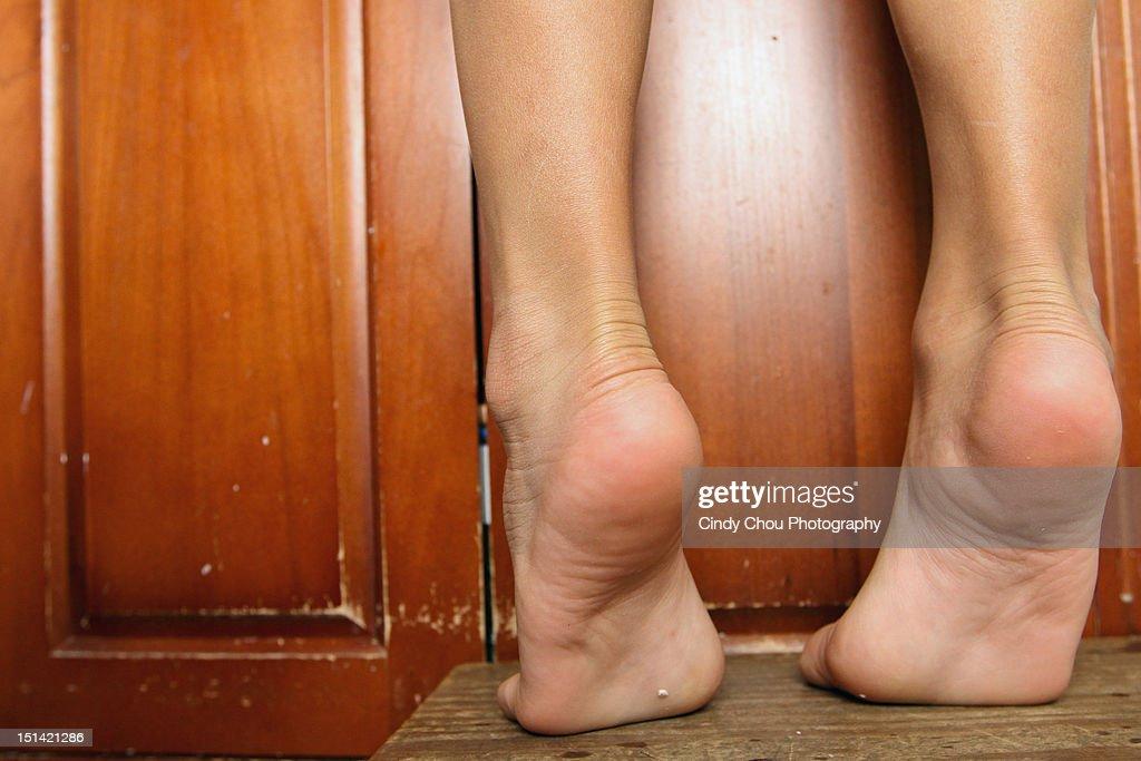 Feet on table : Stock Photo