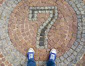 Feet on the cobblestone.