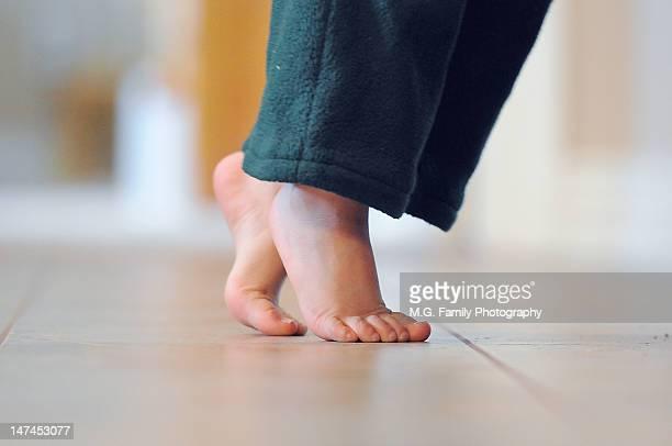 Feet on tip toe