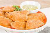 Spanish fried pasty filled with chorizo and cheese served with a garlic, coriander and olive oil dip.