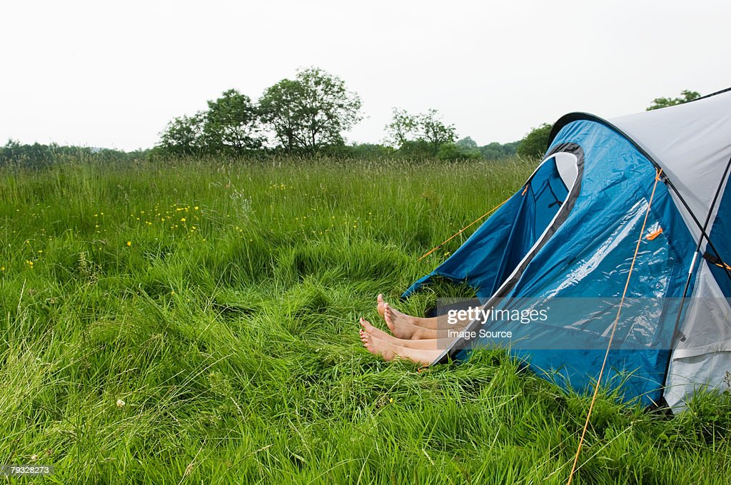 Feet poking out of a tent : Stock Photo