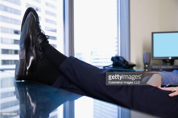 Feet resting on desk