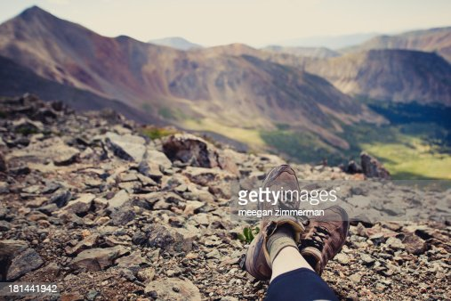 Feet resting on top of mountains