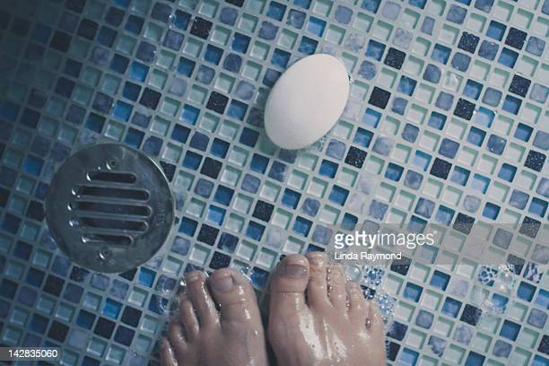 Feet, soap and bubble in shower