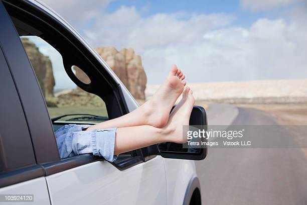 Feet sticking out car window