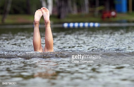 Feet sticking out from water