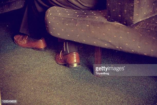 Feet under sofa