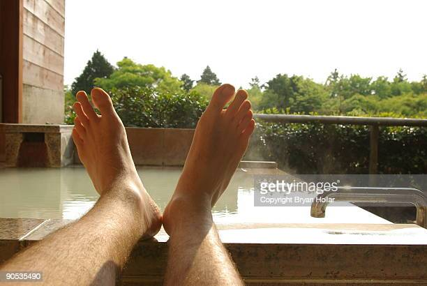Feet up on stone bathtub