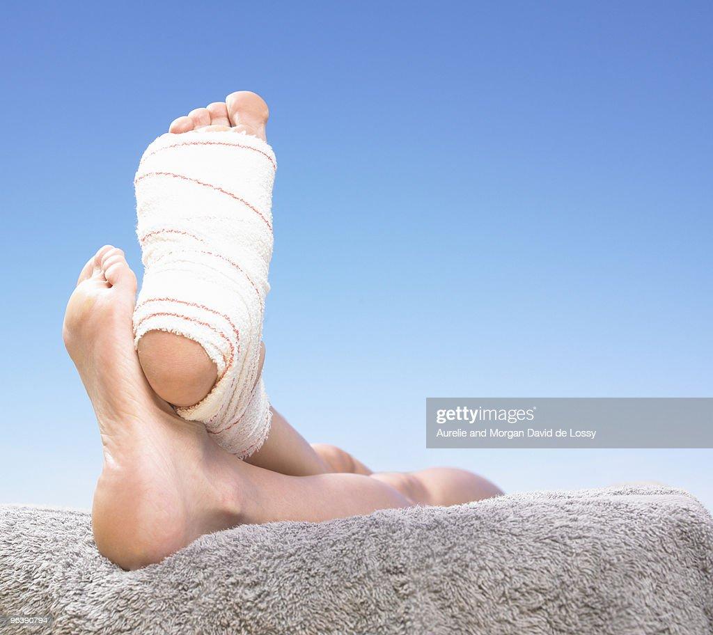 feet with bandage : Stock Photo